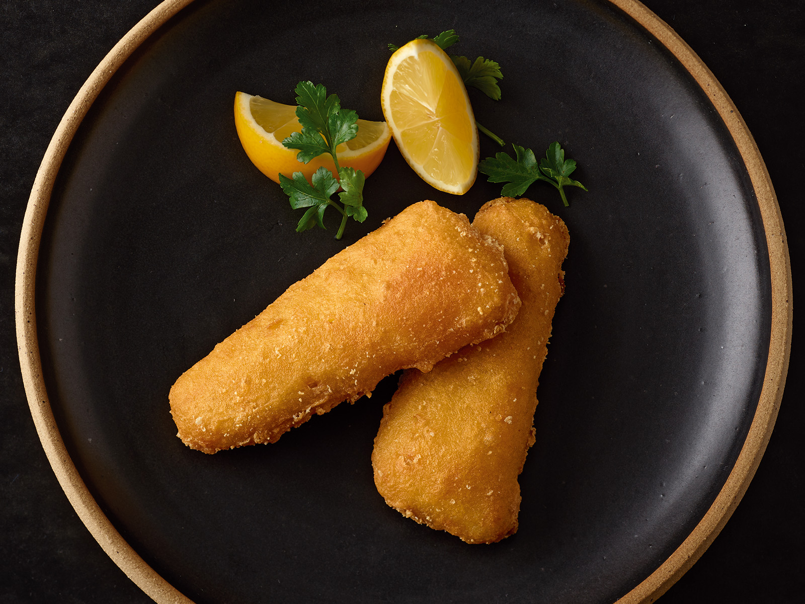 Beer Battered Wild Alaska Pollock made with Budweiser® 2 oz Raw Breaded 426077